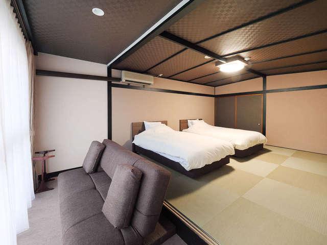 和モダンルーム 「洋室10畳」~シモンズ社製のベッド~